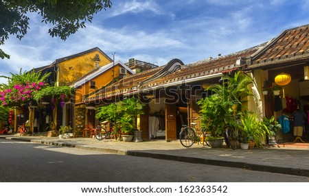 HOI AN, VIETNAM -JULY 21: pedicabs on the street on July 21, 2013 in Hoian, Vietnam. Hoian is recognized as a World Heritage Site by UNESCO. - stock photo
