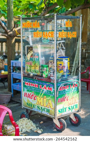 Hoi An - Vietnam Mar 16 ::  Molasses from fresh sugarcane Mobile food shop in Hoi An ancient town on Mar 16, 2015 Vietnam