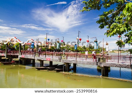 HOI AN, VIETNAM - SEPTEMBER 06: Decorated bridge on the river in Hoi An, Vietnam on Sep 06, 2011. - stock photo