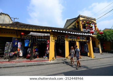HOIAN, VIETNAM, JANUARY 23: Tourists are on street on January 23, 2015 in Hoian, Vietnam. Hoian is recognized as a World Heritage Site by UNESCO. - stock photo