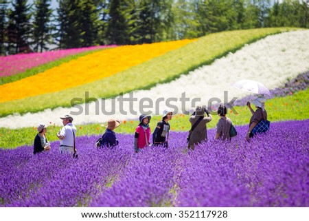 HOKKAIDO, JAPAN-JUL 17 : The landscape of flower garden in Hokkaido while a group of tourist enjoying with photography on Jul 17, 2015.