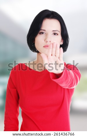 Hold on, Stop gesture showed by young woman hand - stock photo