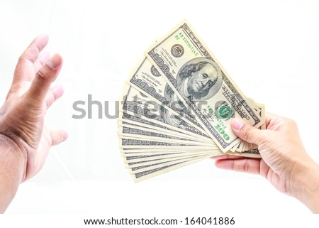 Hold one hundred dollars in hand on white background. - stock photo