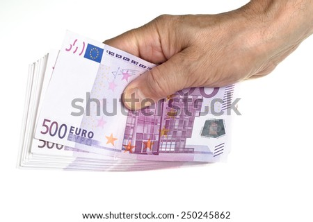 Hold stack of 500 euro in hand on white