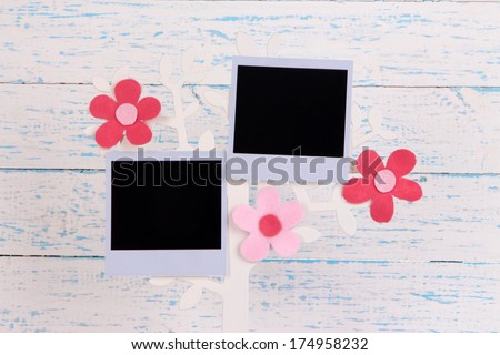 Holder in form of tree with instant photo card on color wooden background