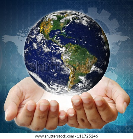 Holding a earth on hands. Earth image provided by Nasa. - stock photo