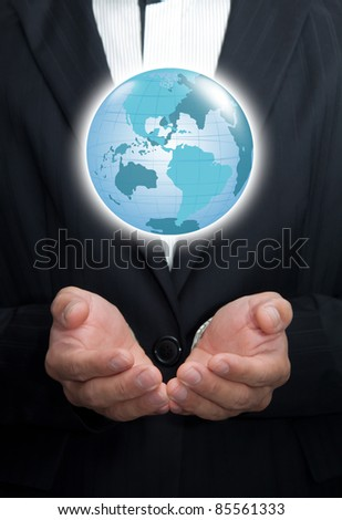 Holding a glowing earth globe in his hands.