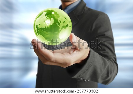 holding a glowing earth globe in his hands. Earth image provided by Nasa - stock photo