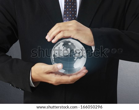 holding a glowing earth globe in his hands ,earth texture by NASA
