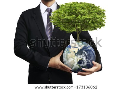 holding a glowing earth (NASA) globe and tree in his hand. Extremely detailed image including elements furnished by NASA - stock photo