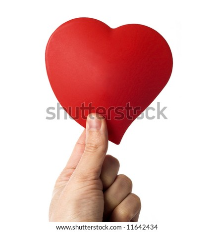 holding a heart shaped figure in hand - stock photo