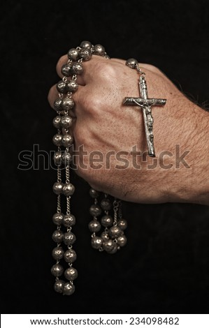 Holding a Rosary - stock photo