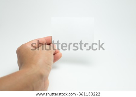 holding a white card on white background.