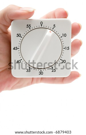 Holding an Egg Timer - stock photo