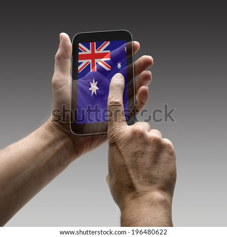 Holding Australia flag screen smart phone. There is a route for hand and finger.  - stock photo