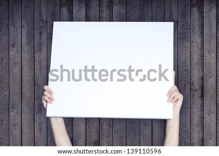 Holding Banner on Wood Background - stock photo
