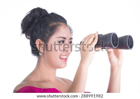 holding binoculars for search and check vision - stock photo