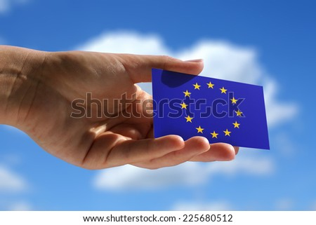 holding blank small flag of European Union - stock photo