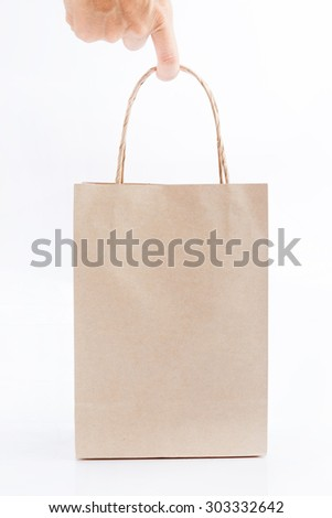 holding brown paper bag isolated on white background