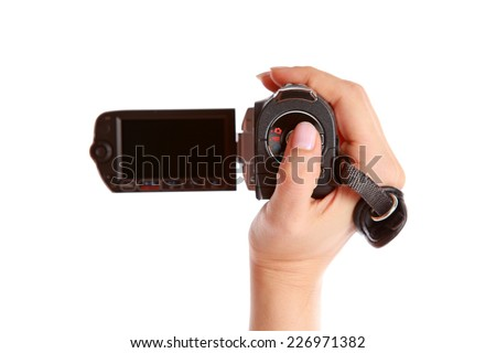 Holding camcorder on the white background. Isolated on white - stock photo