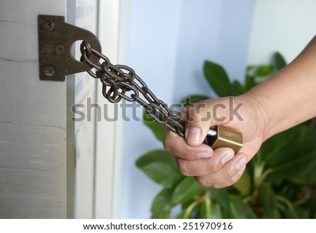 Holding Chain and Key - stock photo