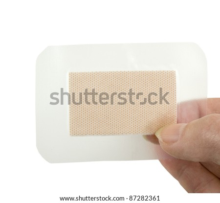 holding clear waterproof bandage on a white background - stock photo