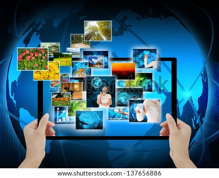 holding Computer display  on technology background - stock photo