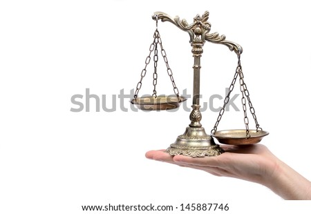 Holding Decorative Scales of Justice,  isolated, law and justice concept. - stock photo