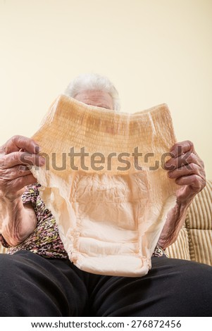 holding diaper (incontinence pad) for adults