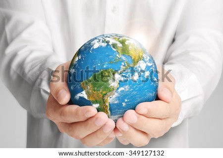 holding global in hands.Ecology concept. Elements of this image are furnished by NASA - stock photo
