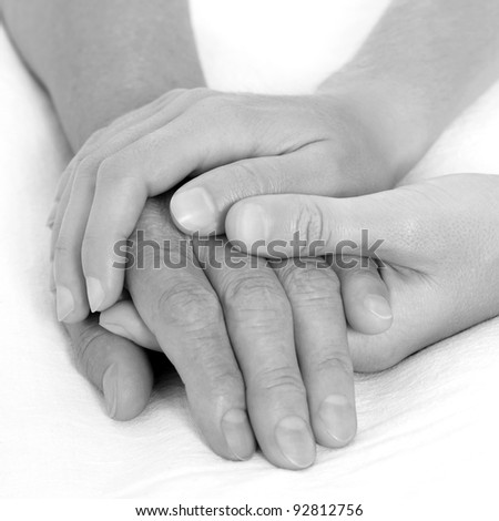 Holding hand black and white - stock photo