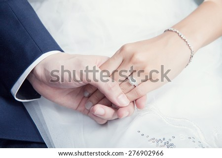 holding hand in wedding ceremony - stock photo