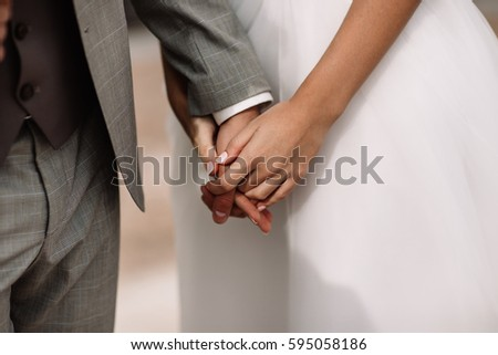 holding hand in wedding ceremony