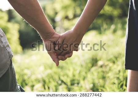 Holding hands, love concept - stock photo