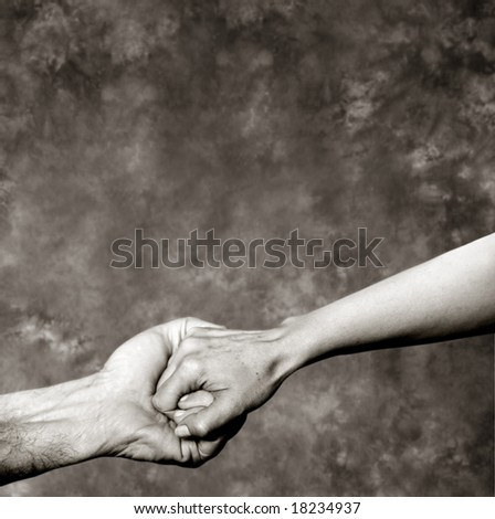 Holding hands on a grey background - stock photo