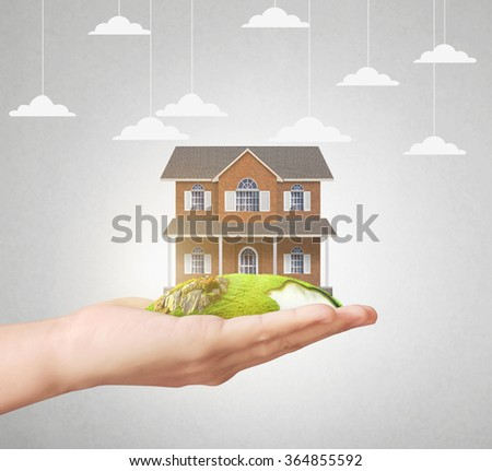 holding home model, loan concept - stock photo