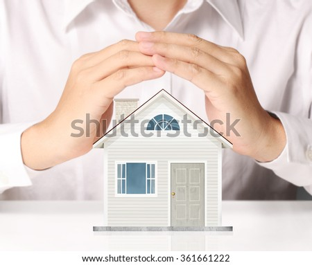 holding house representing home ownership and the Real Estate busines - stock photo