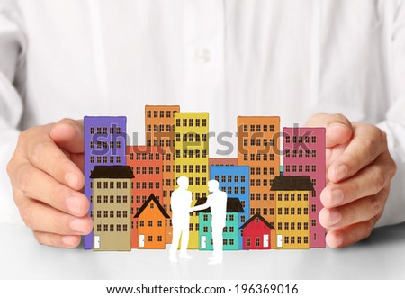 holding house representing home ownership and the Real Estate business  - stock photo