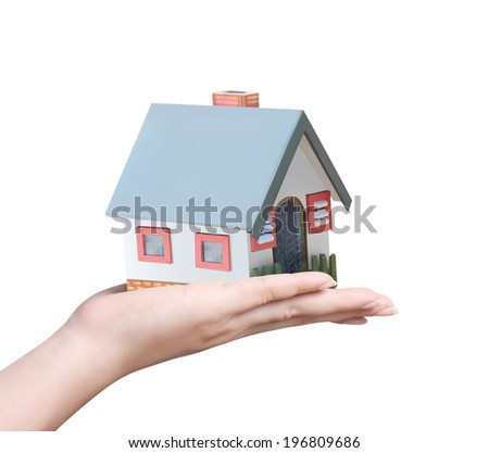 holding house representing home ownership and the Real Estate business