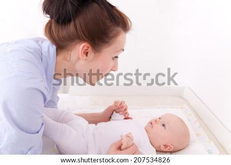 holding kissing little toddler newborn - stock photo