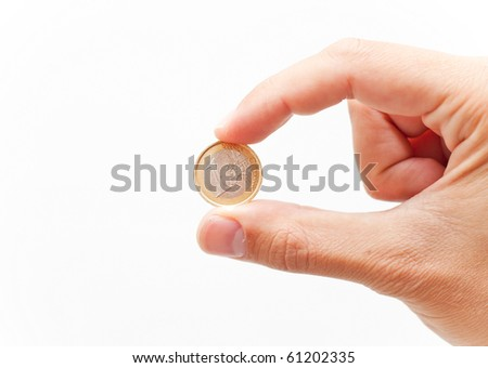 holding one euro coin isolated on white - stock photo