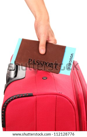 holding passport and suitcase in hand close-up