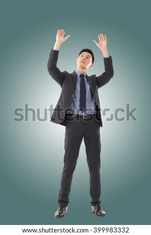 Holding pose of Asian business man, full length isolated. - stock photo