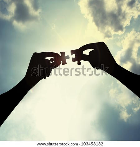 holding puzzle in sky - stock photo