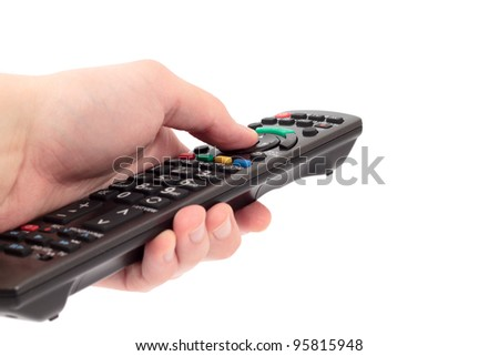 Holding remote control - stock photo