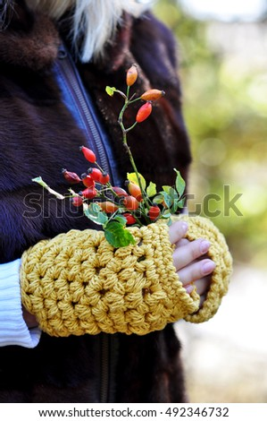 Holding rose hip branches