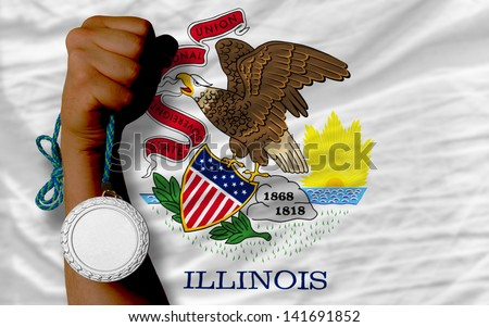 Holding silver medal for sport and flag of us state of illinois - stock photo