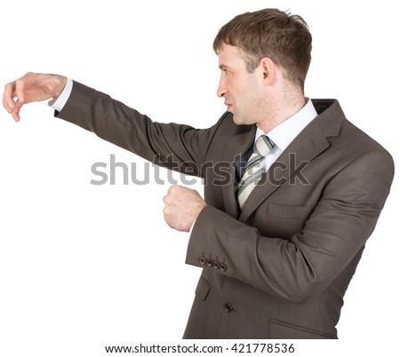 Holding something of hand shape on white background. Businessman hitting copyspace - stock photo