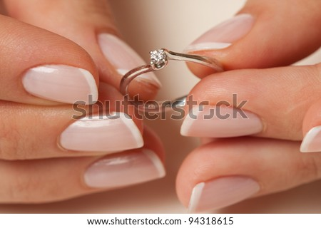 Holding the engagement ring - stock photo