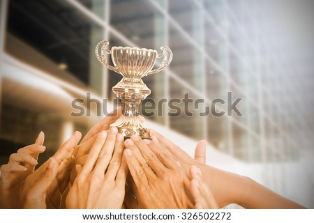 Holding Trophy awards after successful with his business.  - stock photo